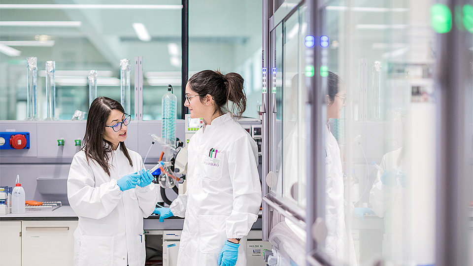 Two women standing in a laboratory